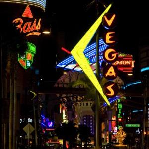 Neon signs lighting up downtown Las Vegas after dark.